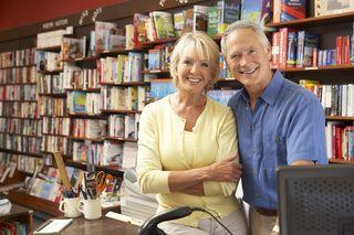Bigstock-Couple-running-bookshop-13904324